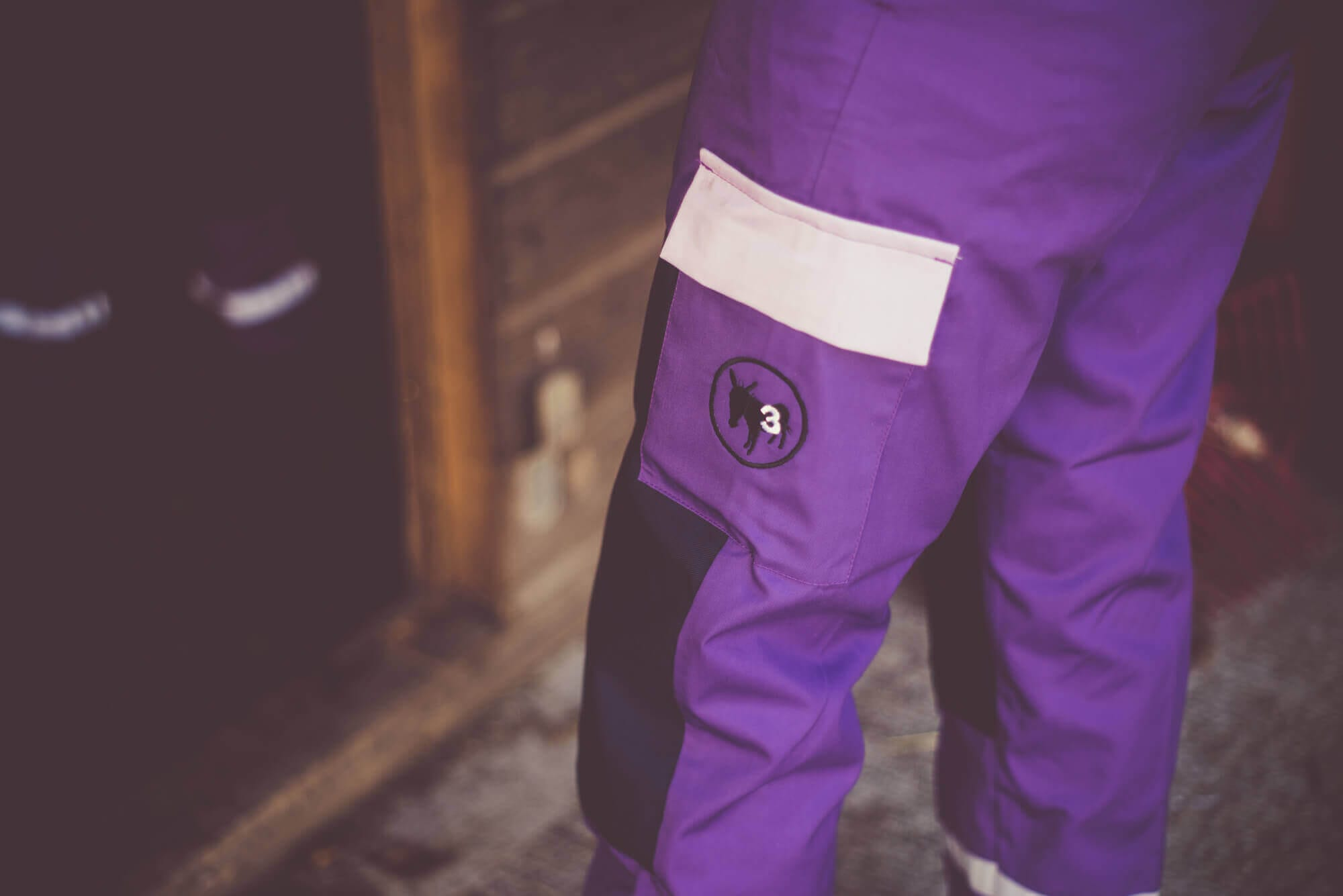 purple coverall pants