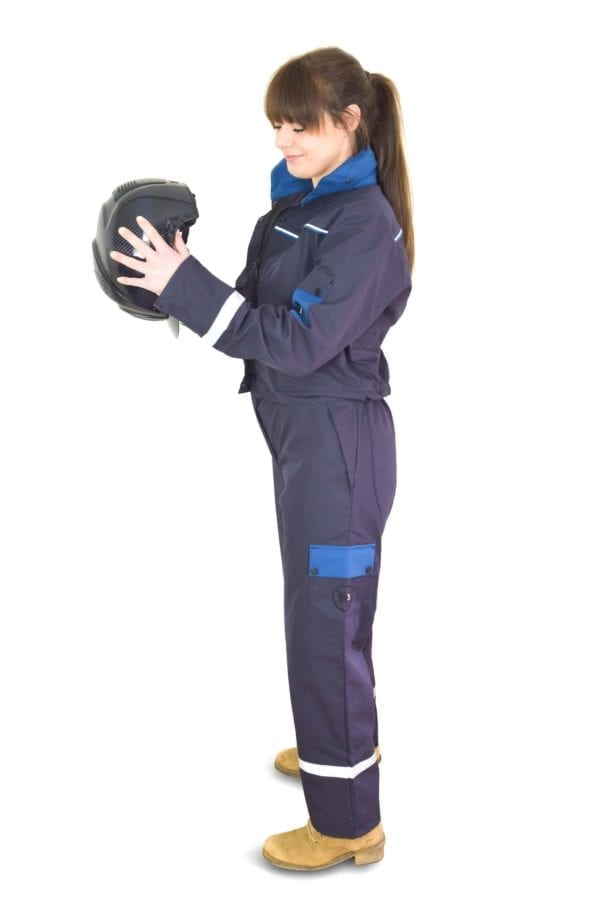 a firl wearing classic blue coverall holding a helmet in side view