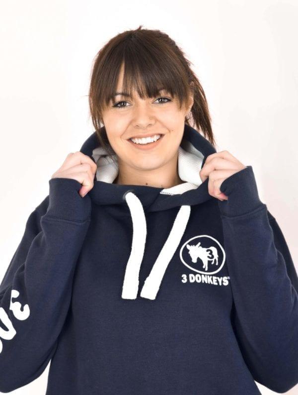 a girl wearing black hoodie jacket smiling